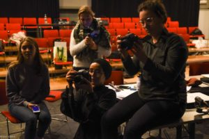 young women learning camera work