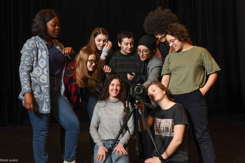 young women behind camera