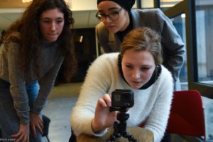 women learn technical skills for filming on gopro